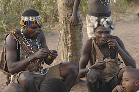 The hadzabe eating after the night hunt